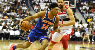 Nov 4, 2018; Washington, DC, USA; New York Knicks guard Allonzo Trier (14) dribbles past Washington Wizards guard Austin Rivers (1) during the first half at Capital One Arena. Mandatory Credit: Brad Mills-USA TODAY Sports
