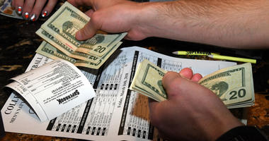 A man makes bets during a viewing party for the NCAA men's college basketball tournament inside Race & Sports SuperBook at the Westgate Las Vegas Resort & Casino on March 15, 2015.