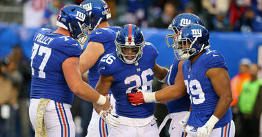 Nov 18, 2018; East Rutherford, NJ, USA; New York Giants running back Saquon Barkley (26) celebrates his touchdown with teammates during the second half at MetLife Stadium. Mandatory Credit: Vincent Carchietta-USA TODAY Sports