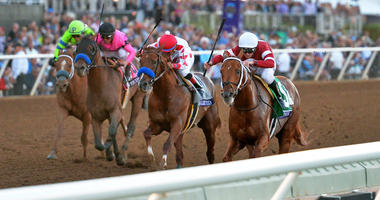 Nov 4, 2017; Del Mar, CA, USA; Gunner Runner (right) leads Collected (middle right) and West Coast (middle left) and War Story (left) to the finish line for the win in the 12th race during the 34th Breeders Cup. Jake Roth-USA TODAY Sports