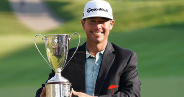 Chez Reavie holds the Travelers Championship trophy after a winning the tournament at TPC River Highlands on June 23, 2019.