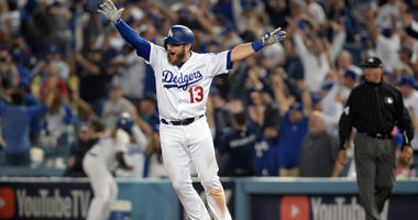 The Dodgers' Max Muncy celebrates after hitting a solo home run against the Boston Red Sox in the 18th inning in Game 3 of the 2018 World Series on Oct. 27, 2018, at Dodger Stadium in Los Angeles.