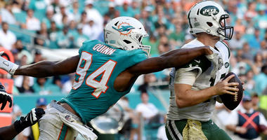 Nov 4, 2018; Miami Gardens, FL, USA; Miami Dolphins defensive end Robert Quinn (94) applies pressure to New York Jets quarterback Sam Darnold (14) during the second half at Hard Rock Stadium. Mandatory Credit: Steve Mitchell-USA TODAY Sports