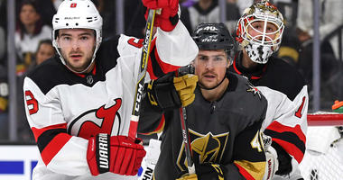 Keith Kinkaid (1) follows the play from behind Vegas Golden Knights center Ryan Carpenter (40) and New Jersey Devils defenseman Will Butcher (8) during the second period at T-Mobile Arena. Mandatory Credit: Stephen R. Sylvanie-USA TODAY Sports