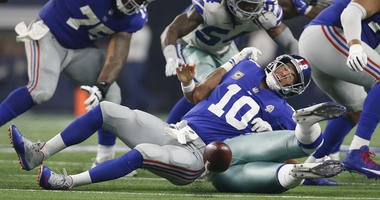 Cowboys linebacker Damien Wilson causes a fumble on a sack of Giants quarterback Eli Manning on Sept. 16, 2018, at AT&T Stadium.