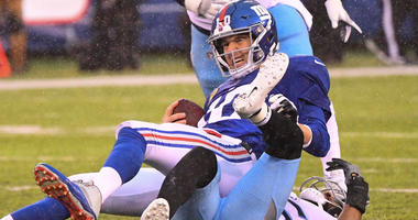 Dec 16, 2018; East Rutherford, NJ, USA; New York Giants quarterback Eli Manning (10) gets sacked by Tennessee Titans cornerback Logan Ryan (26) during the 2nd quarter at MetLife Stadium. Mandatory Credit: Robert Deutsch-USA TODAY Sports