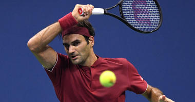 Roger Federer hits to John Millman in a round-of-16 match on Sept, 3, 2018, at USTA Billie Jean King National Tennis Center.