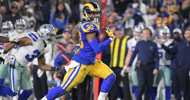 The Rams' Todd Gurley runs the ball against the Dallas Cowboys on Jan. 12, 2019, in an NFC divisional playoff football game at Los Angeles Memorial Coliseum.