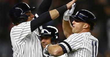 Apr 17, 2019; Bronx, NY, USA; New York Yankees left fielder Brett Gardner (11) celebrates his grand slam home run with Yankees center fielder Mike Tauchman (39) against the Boston Red Sox. Mandatory Credit: Adam Hunger-USA TODAY Sports