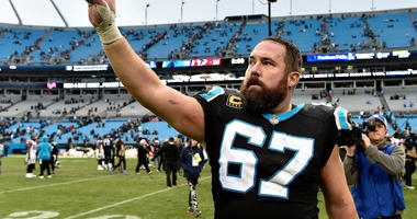 Ryan Kalil #67 of the Carolina Panthers salutes the fans after their game against the Atlanta Falcons