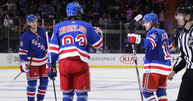 Artemi Panarin #10 (R) of the New York Rangers celebrates his second period goal against the New Jersey Devils and is joined by Jacob Trouba #8 (L) and Mika Zibanejad #93 (C) at Madison Square Garden on September 18, 2019 in New York City.