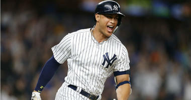 Giancarlo Stanton rounds the bases after hitting a walk off home run against the Seattle Mariners at Yankee Stadium.