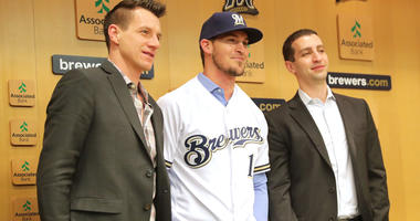 Jan 15, 2019; Milwaukee, WI, USA; Milwaukee Brewers catcher, Yasmani Grandal (center) poses for a photo at a news conference introducing the free agent signing at Miller Park. Mandatory Credit: Mike De Sisti/Milwaukee Journal Sentinel-USA TODAY NETWORK
