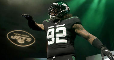 "New York Jets defensive end Leonard Williams models the NFL football team's new ""stealth black"" uniform on April 4, 2019, in New York."
