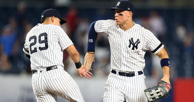Aaron Judge #99 and Gio Urshela #29 of the New York Yankees celebrates after defeating the Colorado Rockies 8-2 at Yankee Stadium on July 19, 2019 in New York City.