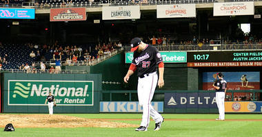 Washington Nationals relief pitcher Shawn Kelley reacts after giving up a two-run home run in the ninth inning against the New York Mets on July 31, 2018, at Nationals Park in Washington, D.C.