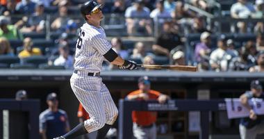 New York Yankees third baseman DJ LeMahieu (26) hits a three run home run in the fifth inning against the Houston Astros at Yankee Stadium on June 23, 2019.