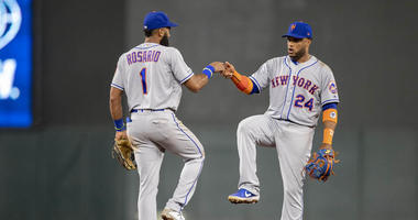 The Mets' Amed Rosario celebrates with Robinson Cano after defeating the Minnesota Twins on July 16, 2019, at Target Field.