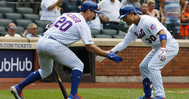 The Mets' Michael Conforto celebrates with Pete Alonso (20) after hitting a solo home run against the Miami Marlins on Aug. 7, 2019, at Citi Field.