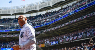 Former Yankees pitcher Mariano Rivera heads out to the mound to throw a ceremonial first pitch before a game against the Baltimore Orioles on Opening Day at Yankee Stadium on March 28, 2019.