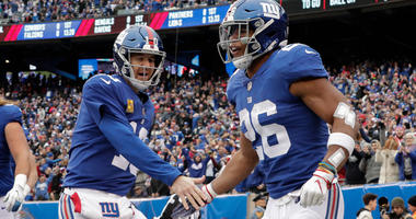 Nov 18, 2018; East Rutherford, NJ, USA; New York Giants running back Saquon Barkley (26) celebrates his touchdown with quarterback Eli Manning (10) during the first half at MetLife Stadium. Mandatory Credit: Vincent Carchietta-USA TODAY Sports