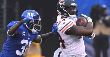 Dec 2, 2018; East Rutherford, NJ, USA;  Chicago Bears running back Jordan Howard (24) runs the ball during the first half as New York Giants safety Michael Thomas (31) defends at MetLife Stadium. Mandatory Credit: Robert Deutsch-USA TODAY Sports