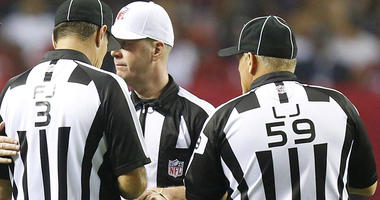 Nov 5, 2012; Atlanta, GA, USA; Dallas Cowboys head coach Jason Garrett talks to the refs during the second half at the Georgia Dome. The Falcons defeated the Cowboys 19-13. Mandatory Credit: Josh D. Weiss-USA TODAY Sports