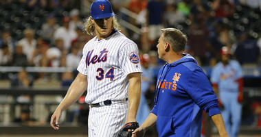 Mets pitcher Noah Syndergaard leaves the field with trainer Brian Chicklo with a leg injury against the St. Louis Cardinals during the seventh inning at Citi Field on June 15, 2019.