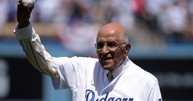 Apr 6, 2015; Los Angeles, CA, USA; Don Newcombe prepares to throw out the ceremonial first pitch before the 2015 MLB opening day game between the San Diego Padres and the Los Angeles Dodgers at Dodger Stadium. Mandatory Credit: Kirby Lee-USA TODAY Sports