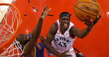 Raptors forward Pascal Siakam shoots the ball against Warriors forward Draymond Green in Game 1 of the NBA Finals on May 30, 2019, in Toronto.