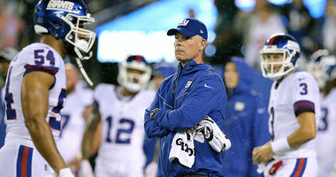 Oct 11, 2018; East Rutherford, NJ, USA; New York Giants head coach Pat Shurmur (middle) looks on during warmups before a game against the Philadelphia Eagles at MetLife Stadium. Mandatory Credit: Brad Penner-USA TODAY Sports