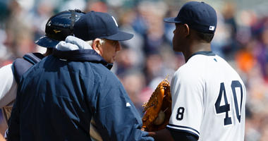 FILE -- Yankees pitching coach Larry Rothschild talks to starting pitcher Luis Severino during a game.