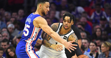 Nets guard D'Angelo Russell looks to pass while being defended by 76ers guard Ben Simmons during Game 5 of a first-round playoff series on April 23, 2019, at Wells Fargo Center in Philadelphia.