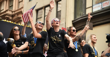 Alex Morgan, Ali Krieger and Megan Rapinoe at The U.S. Women's National Soccer Team Victory Parade and City Hall Ceremony on July 10, 2019 in New York City.