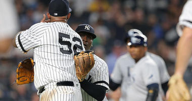 Yankees starting pitcher CC Sabathia (52) is held back by New York Yankees shortstop Didi Gregorious (18) as he argues with Tampa Bay Rays right fielder Avisail Garcia (24) during the sixth inning at Yankee Stadium.