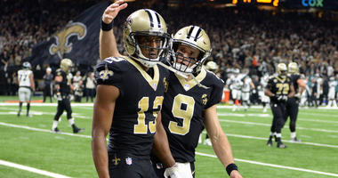 Michael Thomas reacts with quarterback Drew Brees after catching a pass for a touchdown against the Philadelphia Eagles during the third quarter of a NFC Divisional playoff football game at Superdome. Mandatory Credit: John David Mercer-USA TODAY Sports