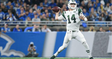 Sam Darnold drops back to pass during the second quarter against the Detroit Lions at Ford Field.