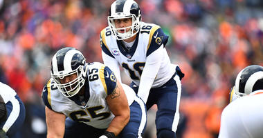 Oct 14, 2018; Denver, CO, USA; Los Angeles Rams quarterback Jared Goff (16) calls for the snap from center John Sullivan (65) in the second half against the Denver Broncos at Broncos Stadium at Mile High. Mandatory Credit: Ron Chenoy-USA TODAY Sports