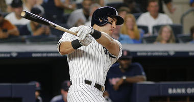 Yankees left fielder Mike Tauchman hits a two-run single against the Boston Red Sox during the third inning at Yankee Stadium.