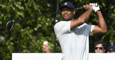 Tiger Woods hits his tee shot on the 17th hole during the first round of The Northern Trust golf tournament on Aug. 9, 2019, at Liberty National Golf Course in Jersey City, New Jersey.