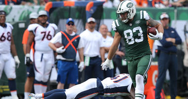 Jets tight end Eric Tomlinson carries the ball past Denver Broncos cornerback Isaac Yiadom on Oct. 7, 2018, at MetLife Stadium.