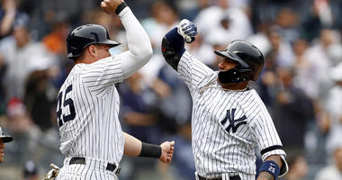 Yankees second baseman Gleyber Torres celebrates a two-run home run against the San Diego Padres with teammate Luke Voit (45) on May 29, 2019, at Yankee Stadium.