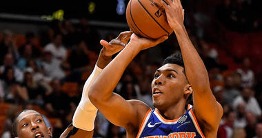 Knicks guard Allonzo Trier shoots over Miami Heat guard Josh Richardson on Oct. 24, 2018, at American Airlines Arena in Miami.