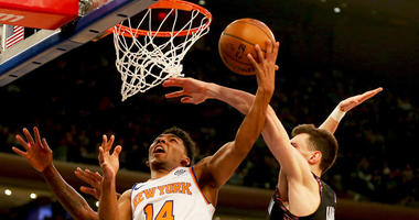 Knicks guard Allonzo Trier goes up for a shot and is fouled by Brooklyn Nets forward Rodions Kurucs on Dec. 8, 2018, at Madison Square Garden.