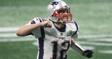 Feb 3, 2019; Atlanta, GA, USA; New England Patriots quarterback Tom Brady (12) celebrates after a Patriots touchdown against the Los Angeles Rams during the fourth quarter of Super Bowl LIII at Mercedes-Benz Stadium. Mandatory Credit: Jason Getz-USA TODAY