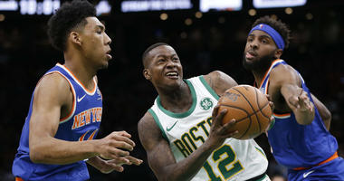 Dec 6, 2018; Boston, MA, USA; Boston Celtics guard Terry Rozier (12) is guarded by New York Knicks guard Allonzo Trier (14) and center Mitchell Robinson (26) during the second half at TD Garden. Mandatory Credit: Greg M. Cooper-USA TODAY Sports