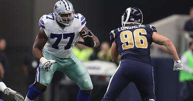 Arlington, TX, USA; Dallas Cowboys tackle Tyron Smith (77) in action against the Los Angeles Rams at AT&T Stadium on Oct 1, 2017.