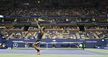 Aug 27, 2018; New York, NY, USA; Rafael Nadal of Spain serves against David Ferrer of Spain (far court) in the first round on day one of the 2018 U.S. Open tennis tournament at USTA Billie Jean King National Tennis Center. Mandatory Credit: Geoff Burke-US