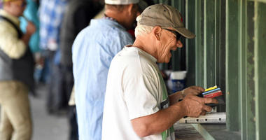 Dave Gambetti places a bet before the 2017 Kentucky Derby at Churchill Downs.