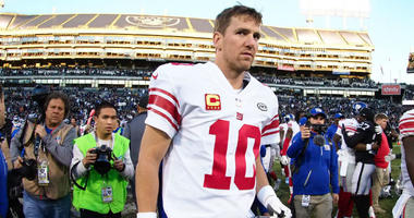 Eli Manning leaves the field after the loss against the Oakland Raiders at Oakland Coliseum.